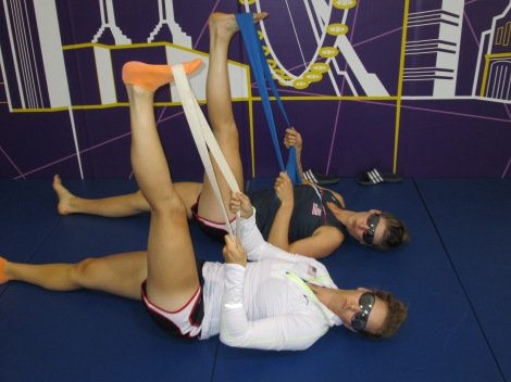Doing some stretching in the village gym with Kara.